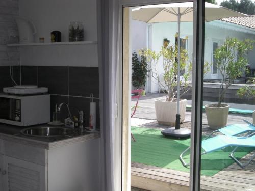 Chambre d'hôte - Cabane Blanche - Vue sur la terrasse